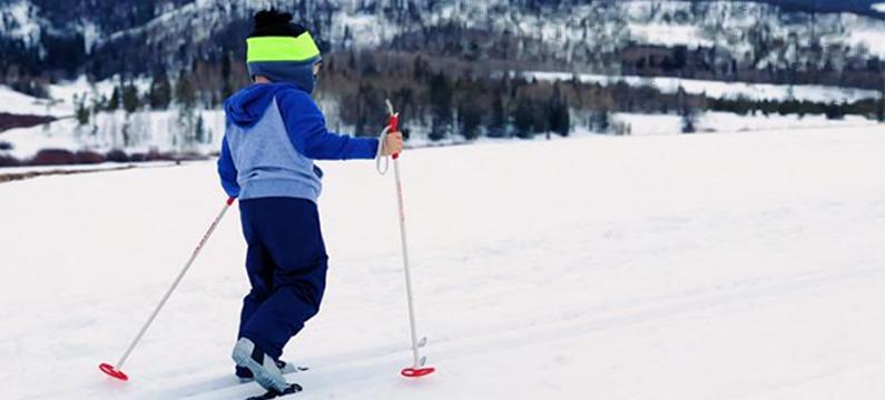 photo of kid cross country skiing
